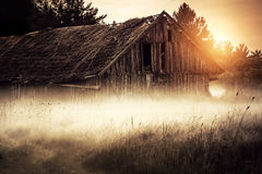 Old rural barn. Old barn or shed in misty field royalty free stock photography