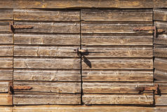 Old rural brown wooden gate with padlock Royalty Free Stock Photos