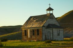 Old Rural Church. An old unused church located in the badlands of Alberta stock photo