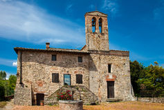 Old rural church in small town in Tuscany Stock Images