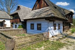 Old rural cottages in musem of the Slovak village. Colorful wooden rural cottages in musem of the Slovak village. Folk architecture stock images