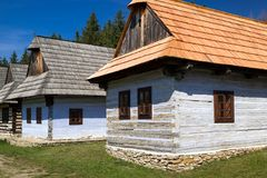 Old rural cottages in musem of the Slovak village. Folk architecture royalty free stock photo