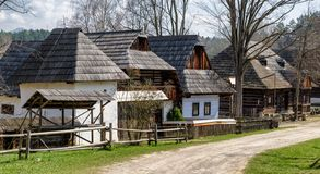 Old rural cottages in musem of the Slovak village. Folk architecture royalty free stock photos