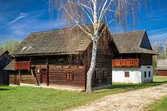 Old rural cottages in musem of the Slovak village. Old wooden cottages in musem of the Slovak village. Folk architecture stock photography