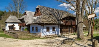 Old rural cottages in musem of the Slovak village. Wooden rural cottages in musem of the Slovak village. Folk architecture stock photos