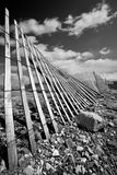 Old rural fence. Running through mountain countryside in Wyoming Stock Image