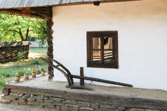 Old rural home in Romania. Window with flower of an  old rural home in Romania Royalty Free Stock Photo