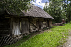 Farm. Old rural homestead surrounded by trees Royalty Free Stock Image