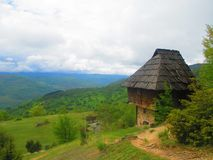 Old rural house on the hill. The old rural house composed of watermills and cloth rolling mills in the Village in Serbia stock photo