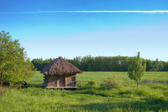 Old rural house with a straw roof Stock Photo