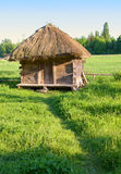 Old rural house with a straw roof Stock Image