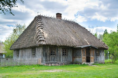 Old rural house with thatched roof Stock Photo
