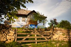 Old rural house with a wooden fenced Royalty Free Stock Images