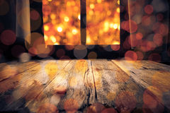 Old rural interior: window table overlooking blurry lights Royalty Free Stock Photo