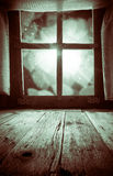 Old rural interior: window table overlooking blurry lights space Stock Images