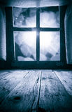 Old rural interior: window table overlooking blurry lights space Royalty Free Stock Photo