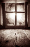 Old rural interior: window table overlooking blurry lights space Royalty Free Stock Photos