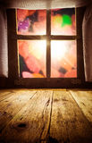 Old rural interior: window table overlooking blurry lights space Royalty Free Stock Image