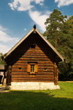 Old rural log hut. The old country log hut costs on a wood edge Stock Photography