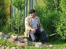 Old rural man resting on a bench Stock Images