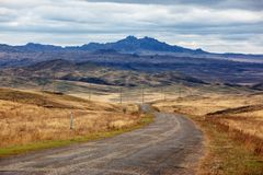 Old rural road in desert mountains Royalty Free Stock Photo