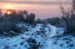 Old rural road in winter desert Royalty Free Stock Photo