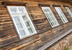 Old rural Russian wooden wall with windows Stock Photography