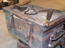 Old rural rusty tools above antique wooden box Royalty Free Stock Image