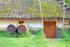Old rural tavern with wooden barrels Stock Image