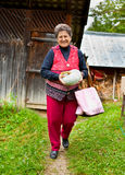 Old rural woman with pumpkin outdoor Royalty Free Stock Image