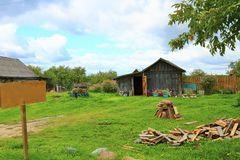 Old rural wooden house in russian village in summer sunny day. with a sign Royalty Free Stock Photography