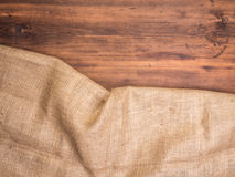 Old rural wooden table boards and burlap vintage background, photo top view. Hessian, sacking texture on wooden. Background for your design. Copy space for your royalty free stock photography