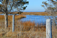 Old Rustic Fence on Ocean Inlet Royalty Free Stock Photography