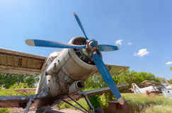 Old russian aircraft An-2 at an abandoned aerodrome. SAMARA, RUSSIA - MAY 25, 2014: Old russian aircraft An-2 at an abandoned aerodrome in summertime. The royalty free stock photography
