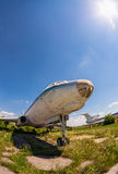 Old russian aircraft Tu-104 at an abandoned aerodrome. SAMARA, RUSSIA - MAY 25, 2014: Old russian aircraft Tu-104 at an abandoned aerodrome in summertime stock photography