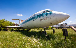 Old russian aircraft Yak-42 at an abandoned aerodrome in summert Royalty Free Stock Photo