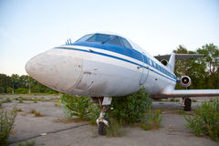 Old russian airplane  is on the disused airfield Royalty Free Stock Photography