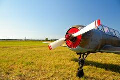 Old russian airplane on green grass Royalty Free Stock Photos