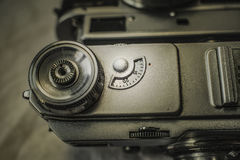 Old Russian analog film cameras with manual controls. Close up view from above of old Russian analog film camera on dirty canvas with vintage look. On the camera stock photo