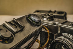 Old Russian analog film cameras with manual controls. Close up view of old Russian analog film camera with vintage look. On the camera, there can be seen stock photography