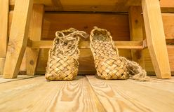 Old russian bast shoes on wooden floor Stock Photo