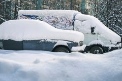 Old russian cars buried under a thick layer of snow. After snow storm Royalty Free Stock Images