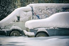 Old russian cars buried under a thick layer of snow. After snow storm Stock Image