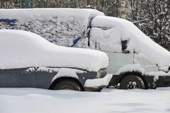 Old russian cars buried under a thick layer of snow. After snow storm Royalty Free Stock Image
