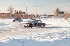 Old Russian cars Lada 2101 and 2104 prepared for racing drive on the ice on a frozen lake, drifting and moving in a skidder in a. Novosibirsk, Russia - 02.02 stock photography
