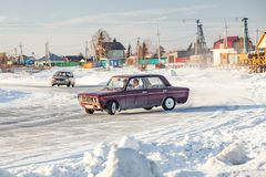 Old Russian cars Lada 2101 and 2104 prepared for racing drive on the ice on a frozen lake, drifting and moving in a skidder in a. Novosibirsk, Russia - 02.02 stock photos