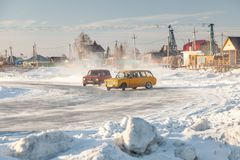 Old Russian cars Lada 2101 and 2104 prepared for racing drive on the ice on a frozen lake, drifting and moving in a skidder in a. Novosibirsk, Russia - 02.02 stock image