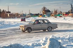 Old Russian cars Lada 2101 and 2104 prepared for racing drive on the ice on a frozen lake, drifting and moving in a skidder in a. Novosibirsk, Russia - 02.02 royalty free stock photography