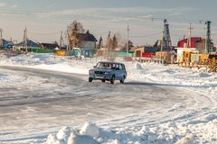 Old Russian cars Lada 2101 and 2104 prepared for racing drive on the ice on a frozen lake, drifting and moving in a skidder in a. Novosibirsk, Russia - 02.02 stock images