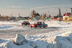Old Russian cars Lada 2101 and 2104 prepared for racing drive on the ice on a frozen lake, drifting and moving in a skidder in a. Novosibirsk, Russia - 02.02 royalty free stock photos